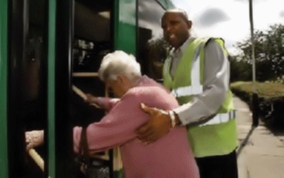 Man helps elderly woman